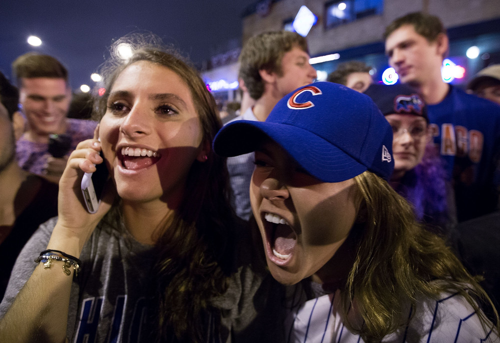 Chicago celebrate the Chicago Cubs 8-7 victory over the Cleveland Indians in Cleveland in 10th inning in game seven of the 2016 World Series, near Wrigley Field in Chicago, Illinois early on November 3, 2016. Ending America's longest sports title drought in dramatic fashion, the Chicago Cubs captured their first World Series since 1908 by defeating the Cleveland Indians 8-7 in a 10-inning thriller that concluded early on November 3. / AFP PHOTO / Tasos KatopodisTASOS KATOPODIS/AFP/Getty Images ORIG FILE ID: AFP_HQ3TW