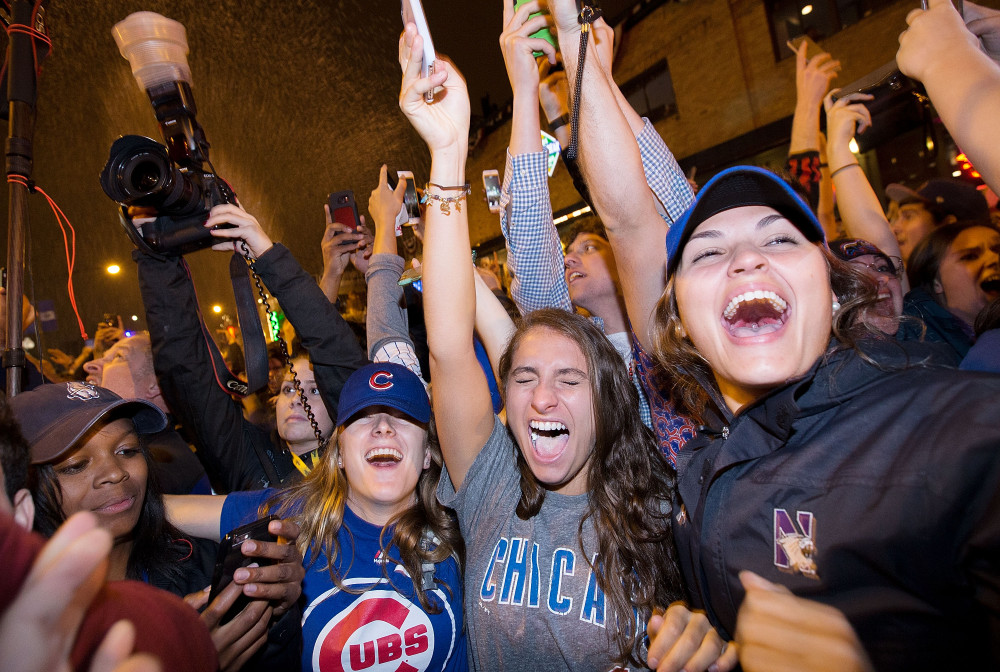 Chicago fans celebrate the Chicago Cubs 8-7 victory over the Cleveland Indians in Cleveland in 10th inning in game seven of the 2016 World Series, near Wrigley Field in Chicago, Illinois early on November 3, 2016. Ending America's longest sports title drought in dramatic fashion, the Chicago Cubs captured their first World Series since 1908 by defeating the Cleveland Indians 8-7 in a 10-inning thriller that concluded early on November 3. / AFP PHOTO / Tasos KatopodisTASOS KATOPODIS/AFP/Getty Images ORIG FILE ID: AFP_HQ3U0