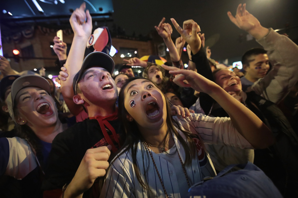 CHICAGO, IL - NOVEMBER 02: Chicago Cubs fans celebrate outside Wrigley Field as the Cubs play the Cleveland Indians during game seven of the 2016 World Series on November 2, 2016 in Chicago, Illinois. The Cubs defeated the Indians 8-7 to win their first World Series title since 1908. (Photo by Scott Olson/Getty Images) ORG XMIT: 680247253 ORIG FILE ID: 620778732